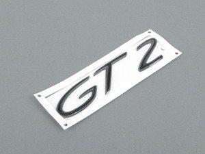 """ES#1493357 - 9965592379170C - """"GT2"""" Logo - Rally Black - Emblem for engine cover - Genuine Porsche - Porsche"""